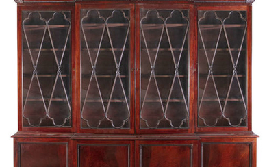 Description A GEORGE IV MAHOGANY BREAKFRONT BOOKCASE, the gadroon...