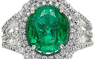 Emerald, Diamond, White Gold Ring The ring centers an...