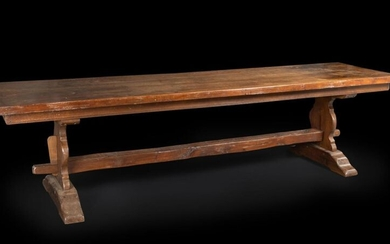 Large table with walnut glides, the 17th century top resting on a baluster profile base (later period).