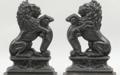 Pair of 19th century English cast iron lion doorstops