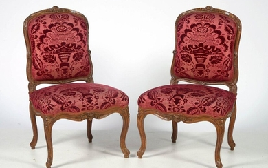Pair of Louis XV style carved walnut chairs in carved walnut with magenta velvet upholstery and floral decoration. Stamped Père Gourdin for Jean Gourdin (circa 1690- 1764). Received master in 1714. French work. Period: 18th century.