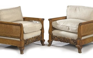 Pair of armchairs in carved beech, with mesh backrest