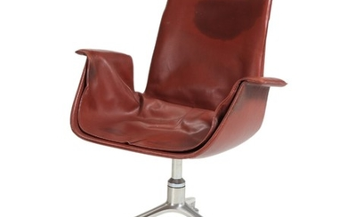 """Preben Fabricius, Jørgen Kastholm: """"Tulip Chair"""". A swivel chair, upholstered with red leather. Manufactured by Walter Knoll."""