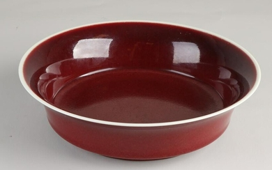 Red glazed Chinese porcelain deep dish. With