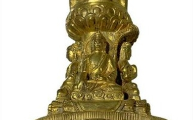Sculpture in gilted bronze stupa with four small Buddha
