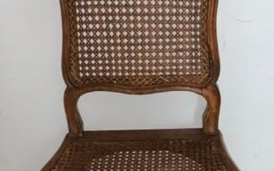 Series of six chairs, wickerwork, natural wood, moulded and carved with florets