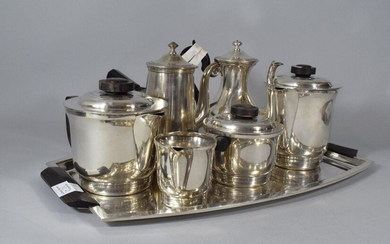 Tea-coffee service in silver plated metal composed of: a tray, a teapot, a coffee pot, a sugar bowl and a milk jug. Decorated with net and rosewood grips.