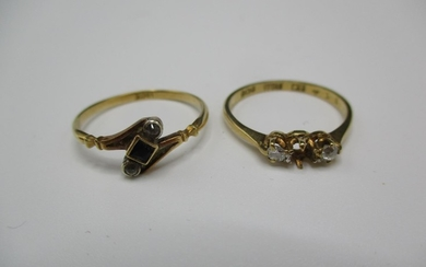 Two 18ct gold rings set with diamonds and white stones Locat...