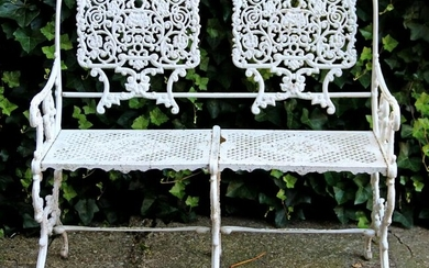 White lacquered wrought iron garden bench with