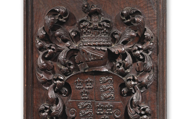 A 19th century carved walnut coat of arms