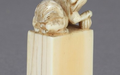 A CHINESE CARVED IVORY SEAL modelled as a Dog of Fo, its rig...