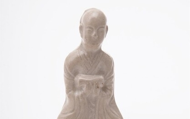A Chinese press-moulded figure of a seated scholar