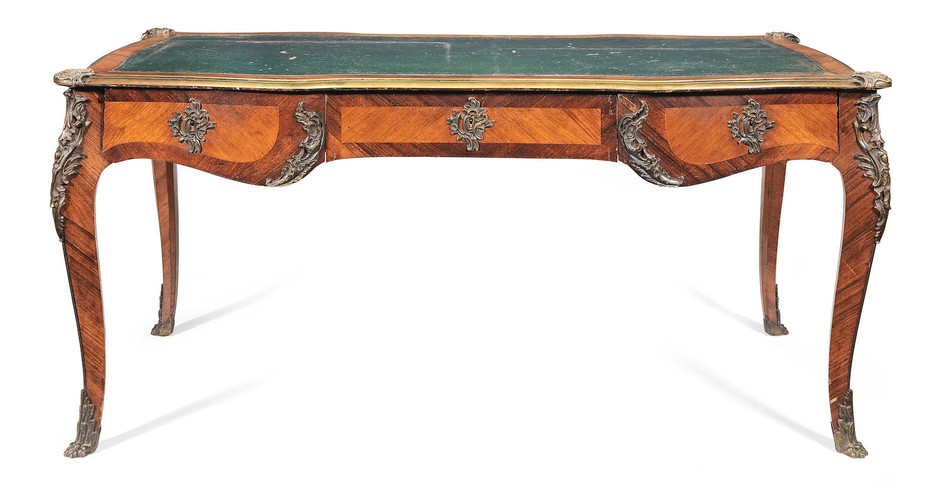 A French late 19th century gilt bronze mounted rosewood and bois satine bureau plat