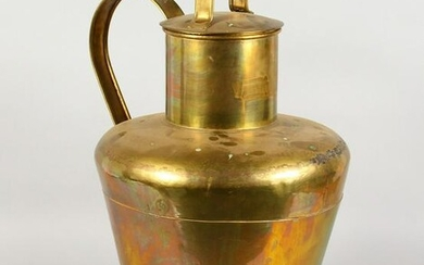 A LARGE BRASS AND COPPER CHURN, with strap handle and