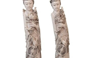 A PAIR OF LARGE IVORY CARVED STANDING LADIES