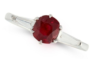 A RUBY AND DIAMOND RING set with a cushion cut ruby of