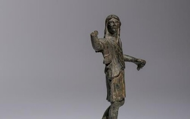 A Roman Bronze Figure of a Man Height 5 5/8 inches.