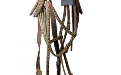 A SNAFFLE BIT WITH BRIDLE AND REINS