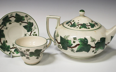 A Wedgwood Napoleon Ivy pattern part service, including a teapot and cover, cups and saucers, tea pl