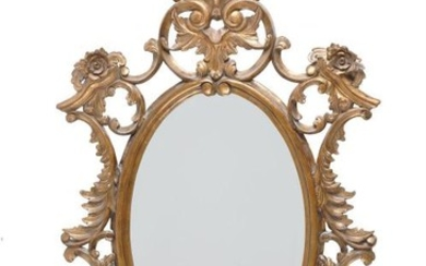 A carved gilt framed oval wall mirror in George III style