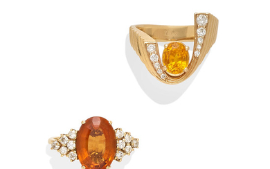 A citrine ring together with a garnet and diamond ring