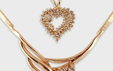 A diamond and fourteen karat gold necklace and pendant
