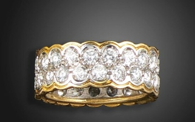 A diamond full-circle eternity ring, set with two rows of round brilliant-cut diamonds with scalloped border in two-colour gold, size L
