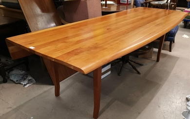 A large modern wakes style table in cherrywood, with shaped ...