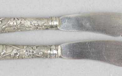 A pair of Chinese export silver butter knives, plus various foreign spoons (low grade). (20).