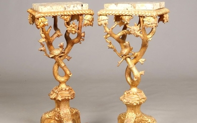 A pair of George II style marble top giltwood torchere stand...
