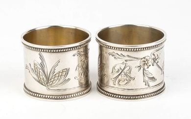 A pair of Russian silver 875/1000 his and hers napkin...