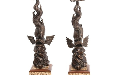 A pair of patinated bronze centrepieces in shape of dolphins. 20th century. H. 56 cm. (2)