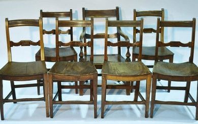 A set of six early 19th Century fruitwood dining chairs;