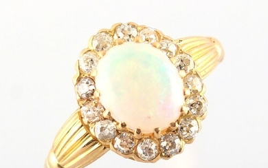 A yellow gold opal & diamond cluster ring, with reeded shoul...