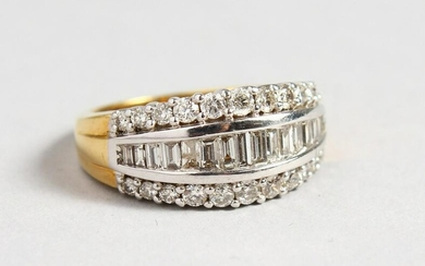 AN 18CT GOLD AND DIAMOND BAGUETTE RING.