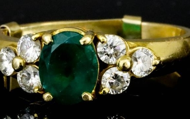 An Emerald and Diamond Ring, Modern, in 18ct gold...