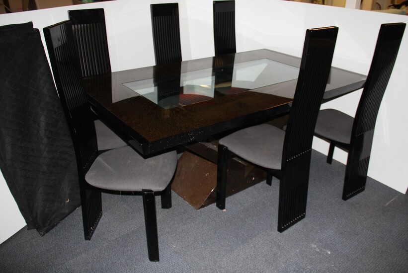 An impressive contemporary black lacquered snakewood dining table and six chairs with a smoked glass centre, extending from 186cm to 276cm. W. 110cm.