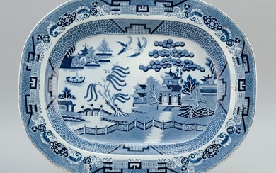 "BLUE AND WHITE BLUE WILLOW TRANSFERWARE PLATTER Ovoid. Unmarked. Length 17.5""."