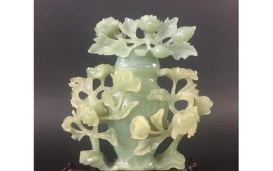 CHINESE GREEN JADE VASE 20th century, carved with flowering ...