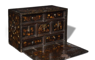 Cabinet in Namban lacquer decorated with flower scrolls, opening to a flap revealing seven drawers, with side handles. 17th century. H: 43 cm, W: 63 cm, D: 33 cm (accidents and restorations)