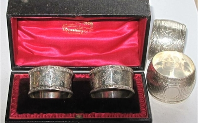 Cased British sterling silver Napkin rings Mappin & Webb, London along with another pair FR3SH