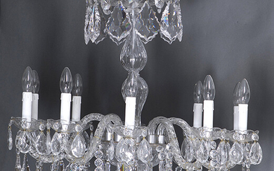 Czech glass lamp with twelve arms of light, Bohemia, 20th century. Decoration of hanging drops, faceted prisms, chains and hanging sphere top. Height: 85 cm approx. Output: 650uros. (108.151 Ptas.)