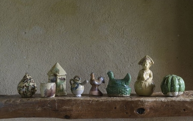 Eight pieces. Six piggy banks: hen on its...