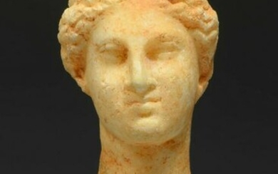 Marble head of a female Goddess, hellenistic, ca. 3rd