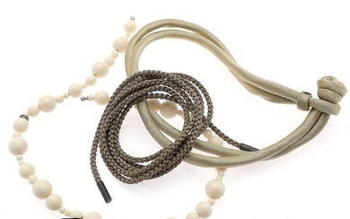 Ole Lynggaard: A collection comprising of a Sweet Drop bracelet, a braided string of silk and a necklace. (3)