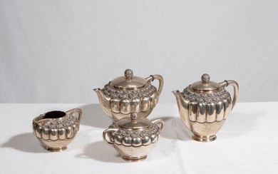 Tea and coffee set in silver plated metal decorated with gadroons and friezes of roses in relief including a teapot, a coffee pot, a sugar bowl, a tray and a milk jug.
