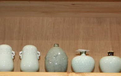 (lot of 9) A group of eight Chinese celadon jars and long neck vases