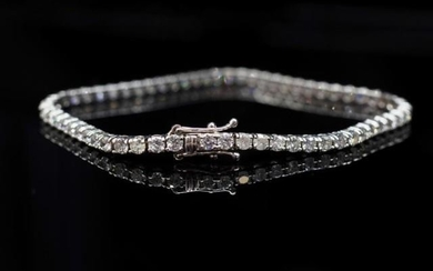 4.50ct diamond and 14ct white gold tennis bracelet marked 14...
