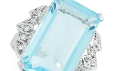 A BLUE TOPAZ AND DIAMOND RING in 18ct white gold, set