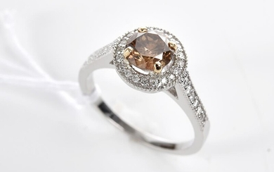 A COGNAC DIAMOND AND DIAMOND RING IN 18CT TWO TONE GOLD, THE CENTRE STONE WEIGHING 1.17CTS,SIZE O, 3.8GMS
